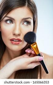 Beauty woman close up face make up portrait. Long hair. Studio young model portrait.