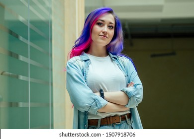 beauty woman creativity colored hair stylist wearing oversized jacket and ripped jeans.