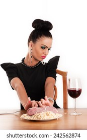 beauty woman with disgust holding a piece of raw meat