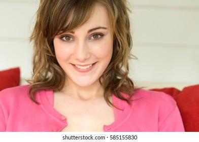 Beauty woman e looking at camera at home