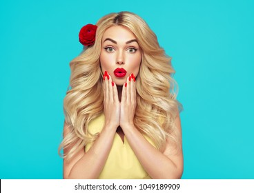 Beauty woman emotion with long curly blonde hair and flower in hair manicured nails beautiful girl summer trendy colors blue and yellow