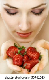 a beauty woman enjoying a fresh strawberry