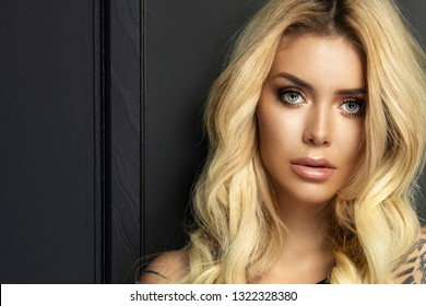 beauty woman with an evening bright makeup in a dark room
