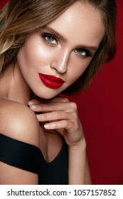 Beauty. Woman Face With Beautiful Makeup And Red Lips. High Quality Image.
