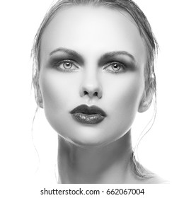 Beauty woman face with bright lips make-up and clean skin. Black and white