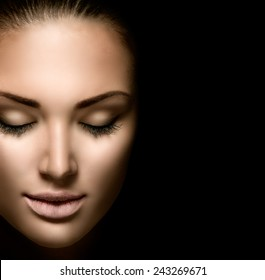 Beauty woman face closeup isolated on black background. Beautiful model girl makeup. Gorgeous lady with closed eyes. Perfect skin and make up