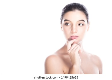 Beauty woman face isolate in white background. Young caucasian girl, perfect skin, cosmetic, spa, beauty treatment concept. Finger on mouth, looking left, copy space, condifent look.