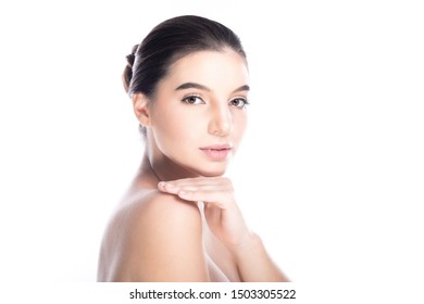 Beauty woman face isolate in white background. Young caucasian girl, perfect skin, cosmetic, spa, beauty treatment concept. Side shot, hand on shoulder.