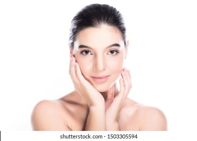 Beauty woman face isolate in white background. Young caucasian girl, perfect skin, cosmetic, spa, beauty treatment concept. Two hands on jaw, smile