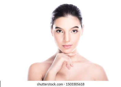 Beauty woman face isolate in white background. Young caucasian girl, perfect skin, cosmetic, spa, beauty treatment concept. One finger on jaw.