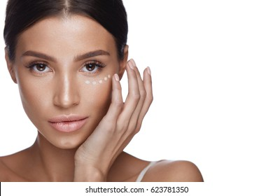 Beauty Woman Face With Makeup. Portrait Of Beautiful Female Touching Soft Smooth Facial Skin With Hands. Closeup Of Sexy Girl With Fresh Make-up And Concealer, Corrector Under Eyes. High Resolution