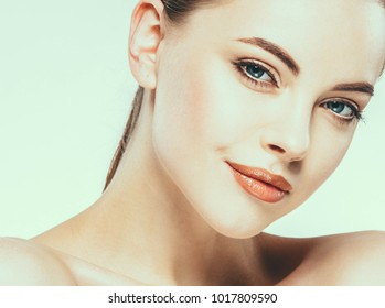 Beauty Woman face Portrait. Beautiful model Girl with Perfect Fresh Clean Skin. Youth and Skin Care Concept. Adult female. Studio shot.