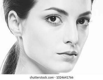 Beauty Woman face Portrait. Beautiful model Girl with Perfect Fresh Clean Skin. Youth and Skin Care Concept. Studio shot. Monochrome