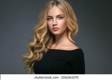 Beauty Woman face Portrait Beautiful Spa model Girl with Perfect Fresh Clean Skin. Shampoo curly long beauty hair. Studio shot.