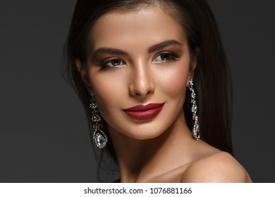 Beauty Woman face Portrait. Beautiful Spa model Girl with Perfect Fresh Clean Skin. Brunette female red lipstick smiling