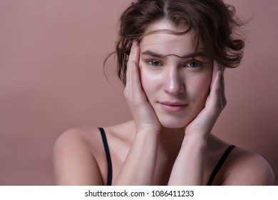 Beauty Woman face Portrait. Beautiful Spa model Girl with Perfect Fresh Clean Skin. Female looking at camera and smiling. Youth and Skin Care Concept