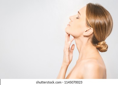 Beauty Woman face Portrait. Beautiful Spa model Girl with Perfect Fresh Clean Skin. Youth and Skin Care Concept
