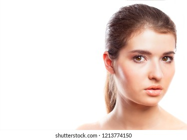 Beauty woman face portrait. Beautiful model girl with perfect clean skin. Youth and skin care concept. Isolated over white background