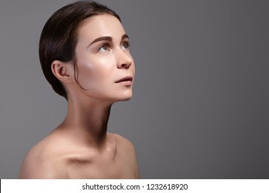 Beauty Woman Face Portrait. Beautiful Spa Model Girl with Perfect Fresh Clean Skin. Youth and Skin Care Concept.