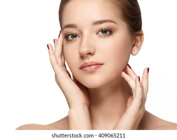 Beauty Woman face Portrait. Beautiful model Girl with Perfect Fresh Clean Skin. Youth and Skin Care Concept. Isolated on a white background