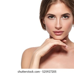 Beauty Woman face Portrait. Beautiful Spa model Girl with Perfect Fresh Clean Skin. Brunette female looking at camera and smiling. Youth and Skin Care Concept.