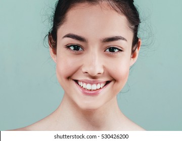 Beauty Woman face Portrait. Beautiful model Girl with Perfect Fresh Clean Skin color lips purple red. Healthy teeth smile Youth and Skin Care Concept. I