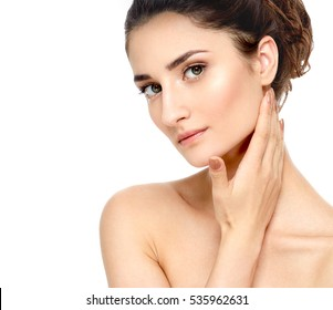 Beauty Woman face Portrait. Beautiful model Girl with Perfect Fresh Clean Skin. Youth and Skin Care Concept. Isolated on a white