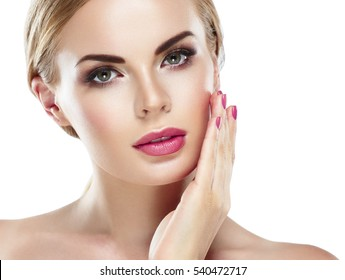 Beauty Woman face Portrait Beautiful Spa model Girl with Perfect Fresh Clean Skin. Woman nail manicure lipstick same color blonde hair Youth and Skin Care Concept. Isolated on a white background