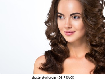 Beauty Woman face Portrait. Beautiful Spa model Girl with Perfect Fresh Clean Skin female looking at camera and smiling. Youth and Skin Care Concept