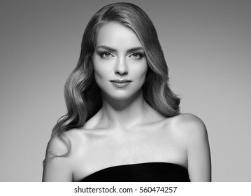 Beauty Woman face Portrait Beautiful Spa model Girl with Perfect Fresh Clean Skin. Blonde model looking camera smiling nude makeup Youth and Skin Care Concept. Black and white.