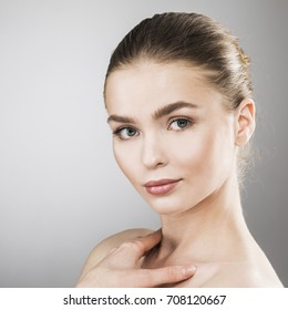 Beauty woman face portrait. Beautiful spa model girl with perfect fresh clean skin. Female looking at camera. Youth and skin care Concept