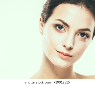 Beauty Woman face Portrait Beautiful model Girl with Perfect Fresh Clean Skin. Youth and Skin Care Concept Plastic Surgery.