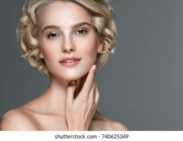 Beauty Woman face Portrait. Beautiful model Girl with Perfect Fresh Clean Skin color lips. Blonde brunette short hair Youth and Skin Care Concept.