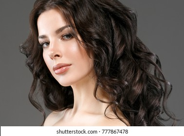 Beauty Woman face Portrait. Beautiful Spa model Girl with Perfect Fresh Clean Skin. Brunette female fresh makeup smiling on gray background. Beautiful hairstyle Youth and Skin Care Concept