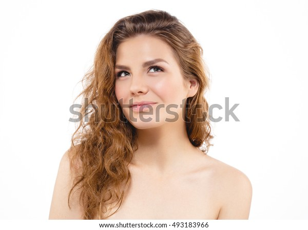 Beauty Woman face Portrait. Beautiful Curly hair model Girl with Perfect Fresh Clean Skin. Blonde female looking camera smiling, nude makeup. Youth and Skin Care Concept. Isolated on white background