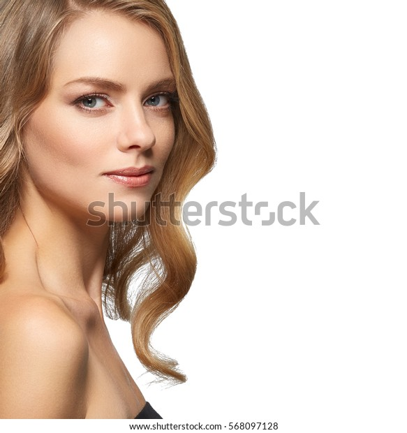 Beauty Woman face Portrait Beautiful Spa model Girl with Perfect Fresh Clean Skin. Blonde model looking camera smiling nude makeup Youth and Skin Care Concept. Isolated on a white background