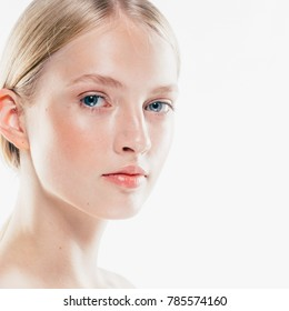 Beauty Woman face Portrait close up. Beautiful model Girl with Perfect Fresh Clean Skin. Studio shot.