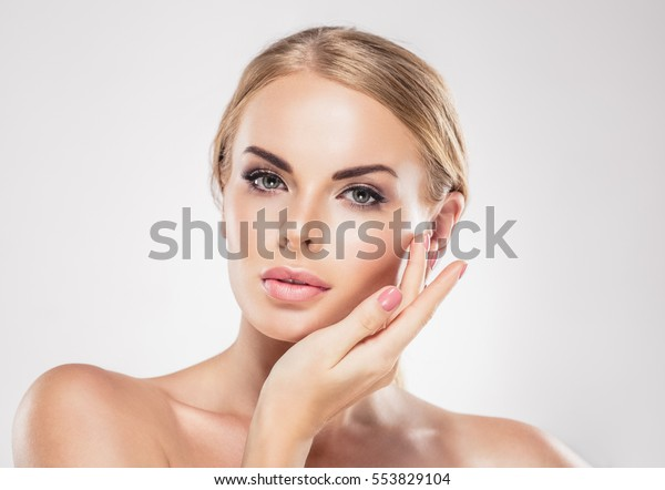 Beauty Woman face Portrait close up. Beautiful model Girl with Perfect Fresh Clean Skin