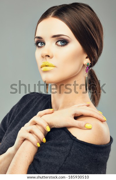 Beauty woman face portrait. Yellow lips. Evening eyes make up. Long hair.