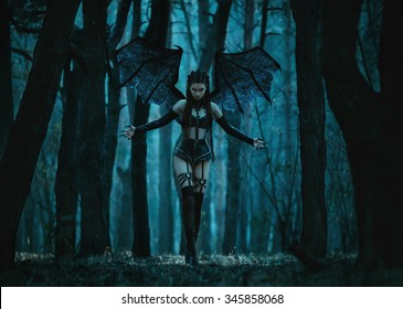 Beauty Woman ghost vampire, evil demon bat wings, succubus in night forest, crazy girl walking in fashion leather black latex sexy outfit. Creative design. Fantasy dark queen. Holiday party Halloween