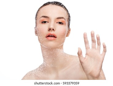 Beauty woman girl natural makeup looking through wet glass on white background