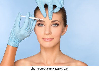 Beauty woman giving medical injections.