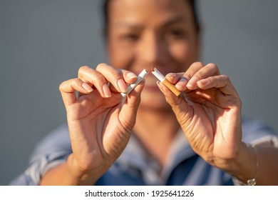 Beauty woman happy to breaking a cigarette. International Wold tobacco day and  quit smoking cigarettes concept.
