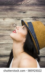 Beauty Woman with hat on a wooden background