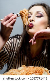 Beauty woman have pasta for dinner. Beauty model eat spaghetti with chopsticks.