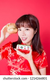 beauty woman hold Mahjong with golden pig bank - rich and ten thousand in chinese word