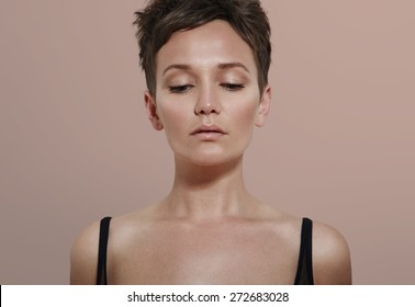 beauty woman with ideal skin looking down
