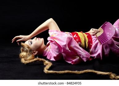 Beauty woman lay in kimono play character