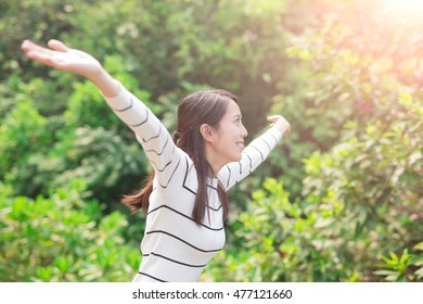 beauty woman make free gesture and smile in forest, asian