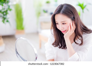 Beauty woman make up and look mirror at home